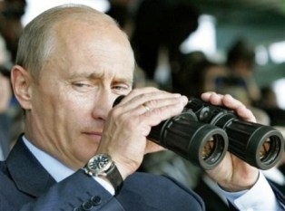 Russian President Vladimir Putin uses binoculars at Chebarkul testing range on Friday, Aug. 17, 2007. Russian and Chinese forces on Friday held their first joint maneuvers on Russia's territory _ an exercise intended to demonstrate their growing military ties and a shared desire to counter U.S. global clout. The war games in Russia's southern Ural Mountains involved some 6,000 troops from Russia and China and also a handful of soldiers from four ex-Soviet Central Asian nations that are part of the Shanghai Cooperation Organization, a regional group dominated by Moscow and Beijing.  (AP Photo/RIA-Novosti, Dmitry Astakhov, Presidential Press Service)